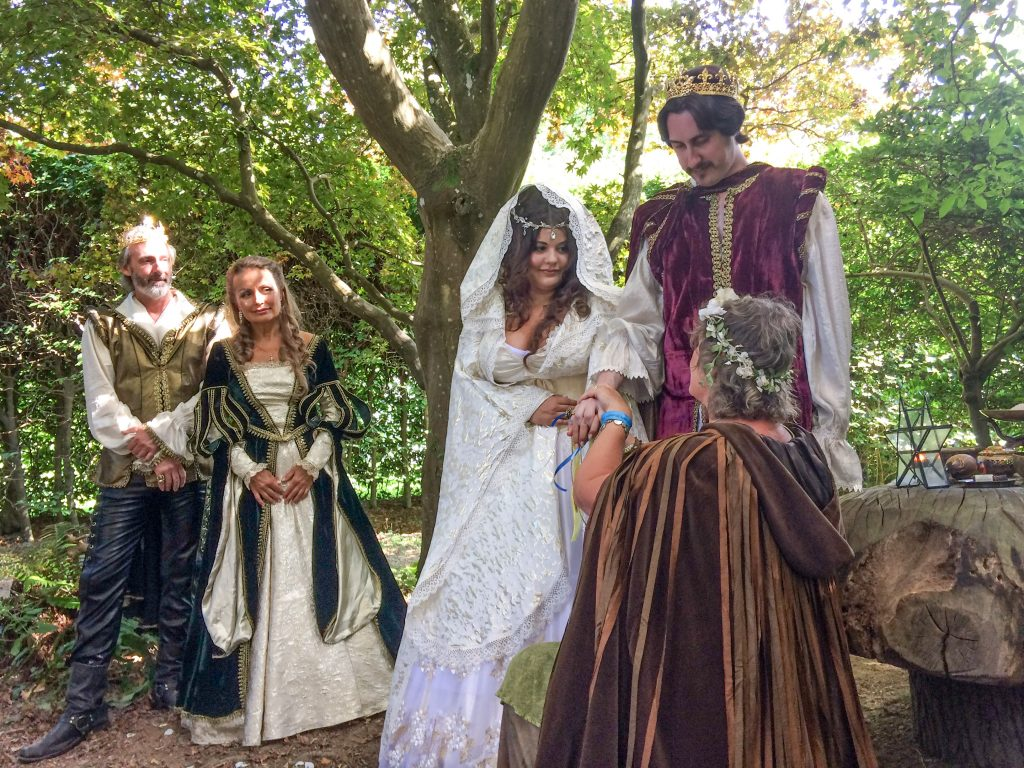 Medieval handfasting part of woodland wedding ceremony performed by Glenda Procter